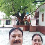 The neem tree in the background and the cottage, birth place of Mhaprabhu.