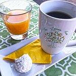 Hot Americano, accessorized w/powdered cookie; fresh squeezed orange juice
