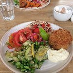 Smoked haddock fish cake with three different salad portions and a dollop of lemon mayo!