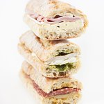 Sandwiches made daily! (From top to bottom: Ham and brie, chicken and mozzarella, salami and swi