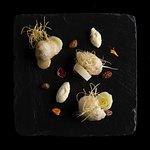 Ostriche in tempura di grano saraceno, porri e burro bianco soffiato