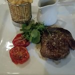 Delicioua juicy and tender Rib-Eye steak well done with peppercorn sauce