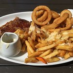 Steak, cheesy chips and onion rings.