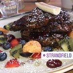 Strandfield Cafe Florist & Grocer resmi
