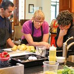 Patrons discussing ingredients with one of our Chef's in our Hands-On Kitchen