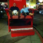 Goofing around in the giant Adirondack chair by Filippi's.