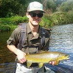 Happy angler with a Waikato Brown
