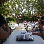 Visitors enjoying great food at scotchies restaurant in Ocho Rios.
