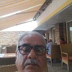 Selfie in the restaurant giving backside view