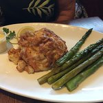 10 ounce Crab Cake with a side of Asparagus.