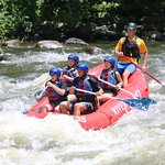 He we are hitting the rapids and having a great time with Bryce our rafting leader!