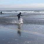 Kids on a bogie board playing in the cold water