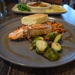 Honey Maple Glazed Salmon with sweet potato and corn hash Brussels sprouts and corn bread
