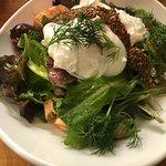 Salmon Hash Dish featuring wild organic salmon, braised greens, mustard seed caviar, and fresh d