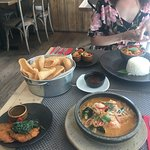 Tom yum, fish cakes, dumplings, red curry and crackers