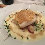 Seared Halibut with a mustard sauce served over a gratin of badly potatoes and leeks