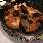 1 of the 2 orders of Paella with shrimp, clams, mussels, chicken and sausage