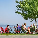 Cyclists having breakfast on the lake from the Prague Café