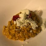 Risotto with tomatoes, basil, and iced ricotta cheese