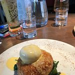 Fish cake starter with poached egg and hollandaise