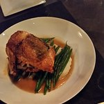 Roasted chicken with truffle oil infused mushrooms, croutons, whipped potatoes, and string beans