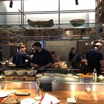 Open kitchen in the center of the restaurant