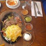Beef fajitas, condiments and a pina colada.