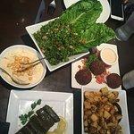 Filling the table with this wonderful food! Hummus, Tabouleh, Falafel, Grape Leaves & Batata Har