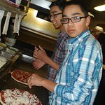 Owners are family friends so they allowed my sons to make their own pizza.