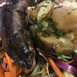 a trout with leathery tough skin and cold spuds, unappetising garted carrot insted of watercress