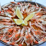 Delicious paella full with many types of seafood