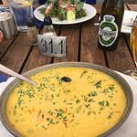 Salmon salad, seafood soup with saffron and herbs, Tuborg