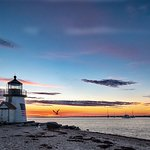 July Brant Point sunrise with tallship Lynx.