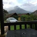 Taken from our room's patio. That's our rental car, a couple of the cabins and Arenal in the clo
