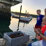 They came down to the pier to pull up a 100 lbs crate of lobster reserve.