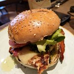 delicious chicken burger with bacon, cheese and pesto