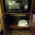 Microwave with plates, utensils and napkins supplied by hotel.