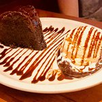 Chocolate Cake and Ice Cream with chocolate drizzle over everything