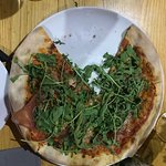 Pizza with a very dry rucola leaves
