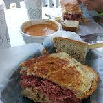 One half of the reuben sandwich with soup