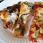 Left, Caramelized onion & mushroom; Garlic scapes, tomato, goat cheese; Roasted pepper, artichok