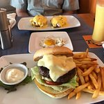 The XL burger, eggs Benedict in the background, and passion smoothies on the side