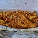 Fish n chips covered with scraps.