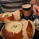 The delicious clam chowder served in freshly baked sourdough loaf