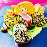 Sesame crusted tuna with citrus sauce, potatoes and carrots