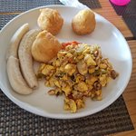 ackee and saltfish with green banana and fried dumpling