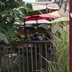 Umbrella covered patio at Melanie's