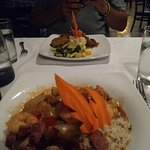 Jambalaya in foreground, meatloaf entree in background. Beautiful presentation.