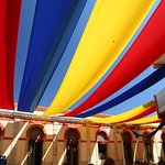 the side streets are shaded to keep them cool with these colouful canopies.