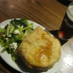 A steak-and-mushroom pie, along with a beer, at Elephant & Castle restaurant.